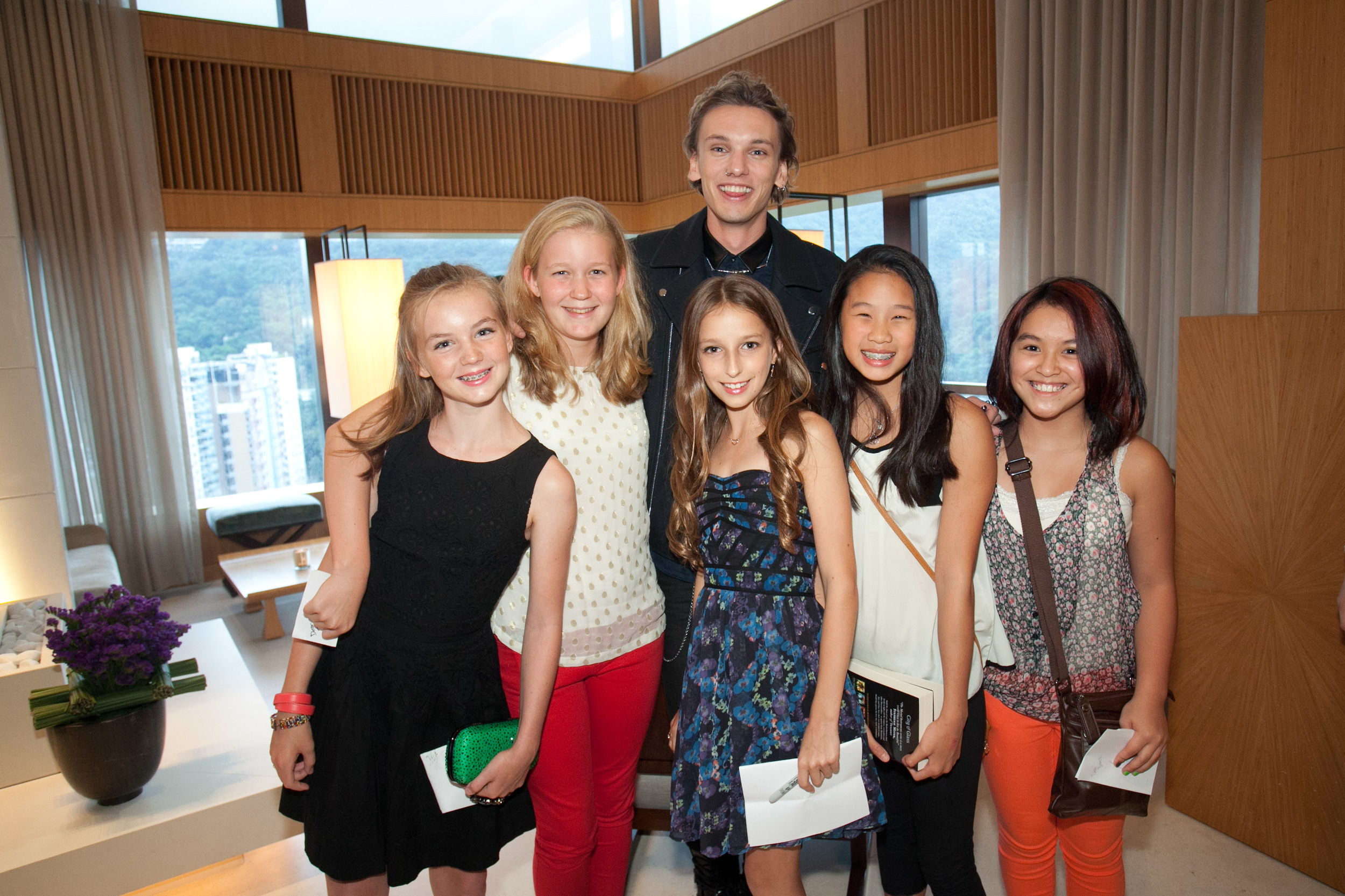 Jamie Campbell Bower and some young guests