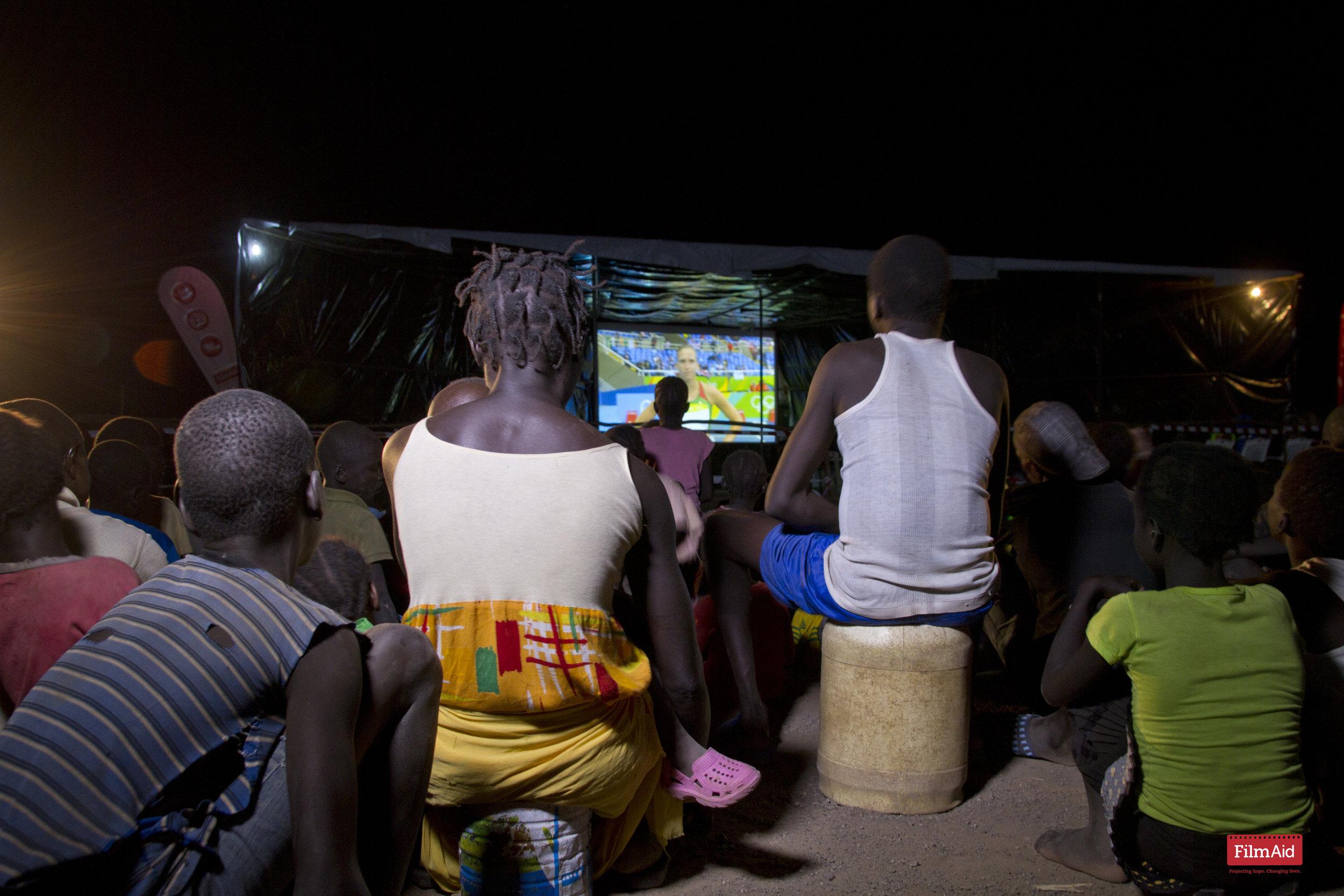 Community watches The Olympic Games - Kakuma - ©FilmAid/Otieno