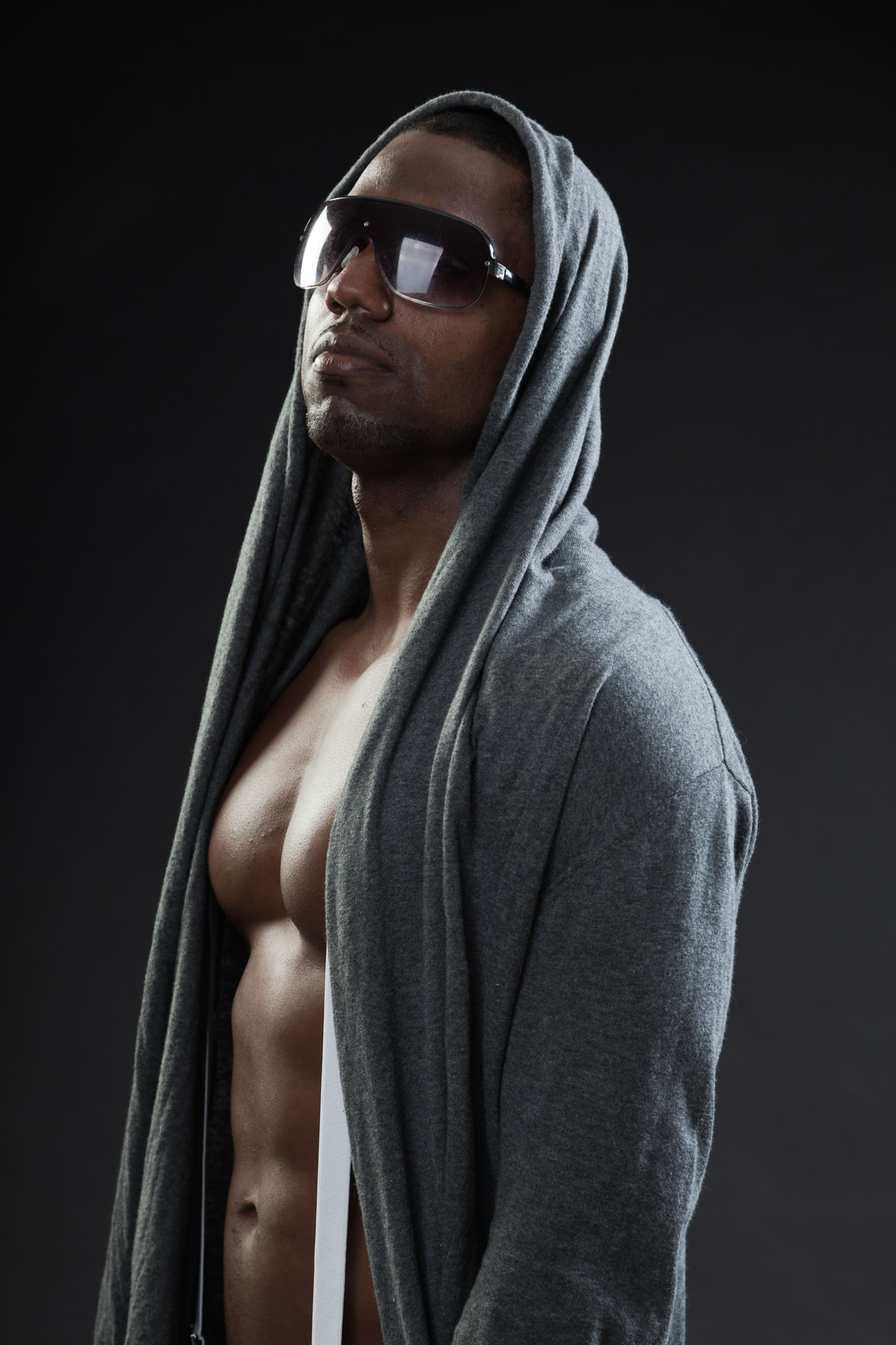 Black fitness man urban style with dark sunglasses. Studio shot.