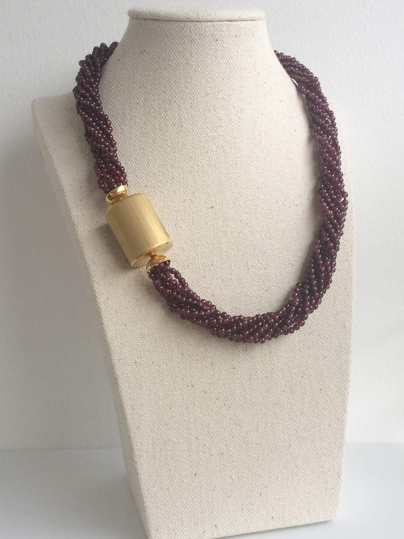 Garnet multistrand necklace with extra large gold cylinder clasp