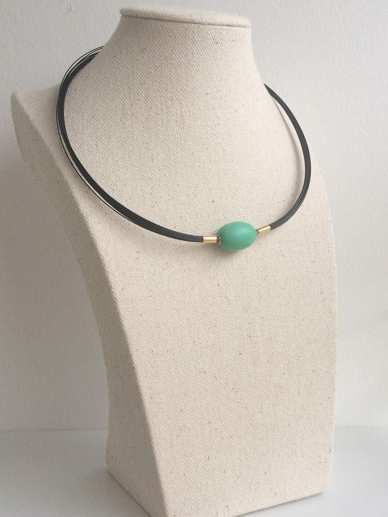 Matte ovoid chrysoprase clasp on interchangeable black steel multistrand necklace