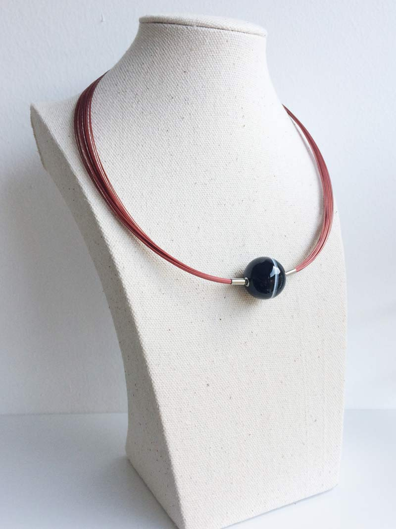 Red wire multistrand with banded black onyx clasp
