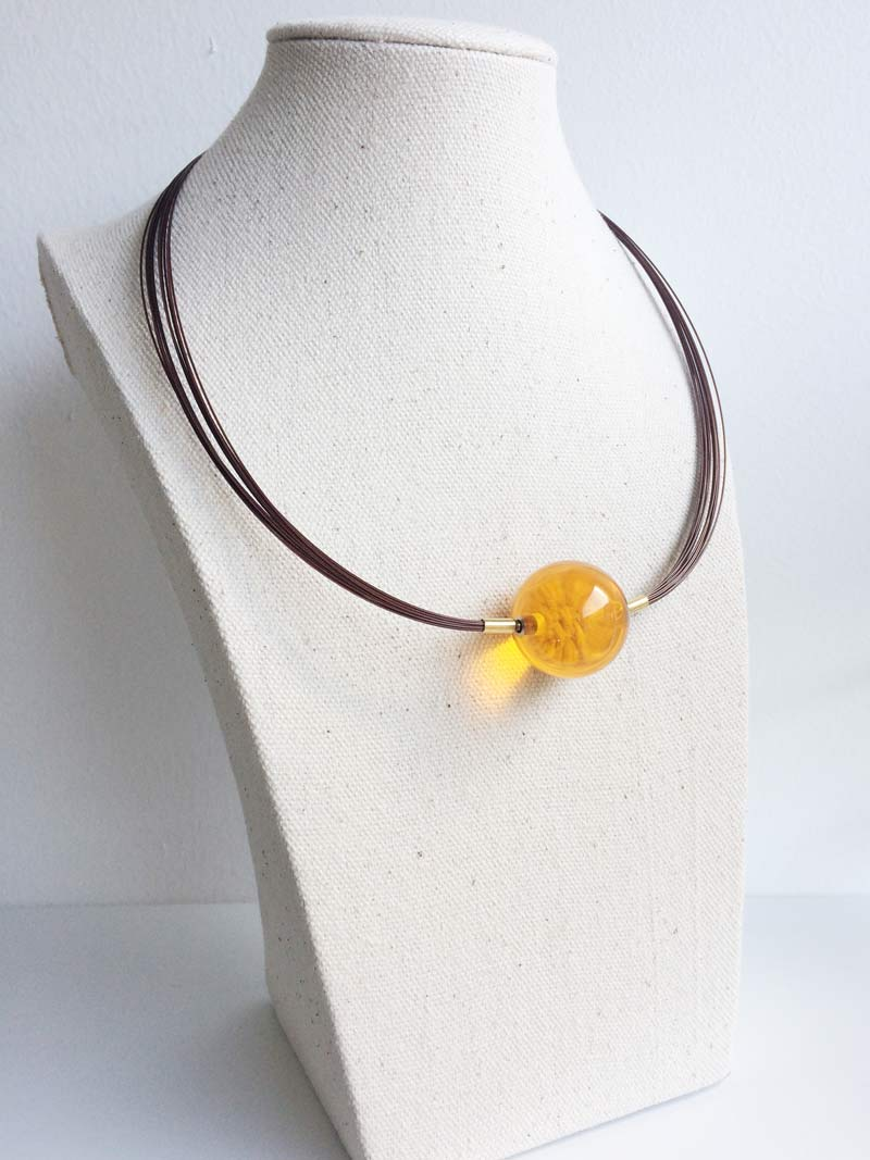 Brown wire multistrand necklace with interchangeable yellow glass clasp