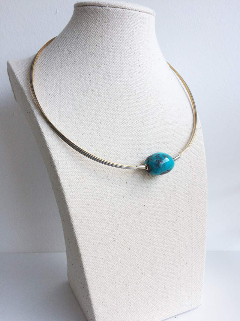 Two tone multistrand necklet with interchangeable deep turquoise clasp