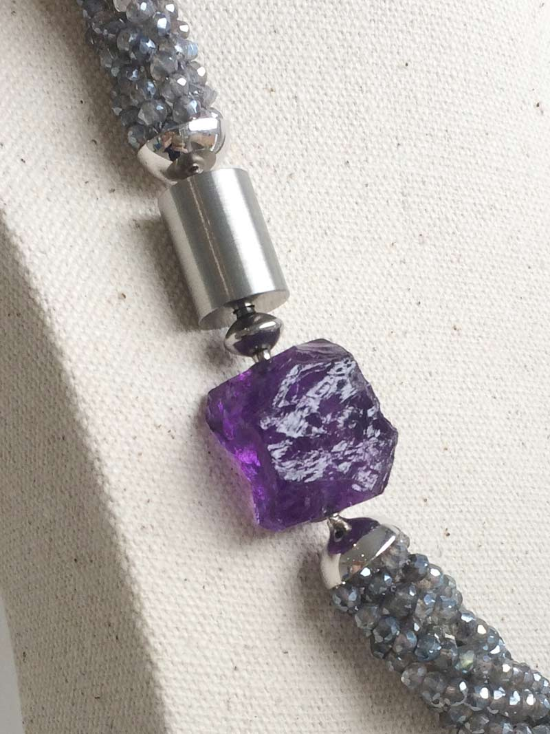 Steel adaptor between small steel cylinder and  amethyst nugget  clasps on  labradorite multistrand necklace