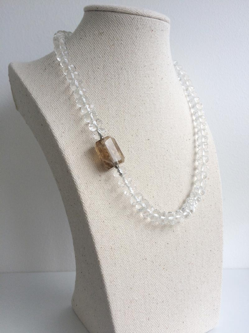 Faceted rock crystal necklace with small hexagonal smoky quartz clasp