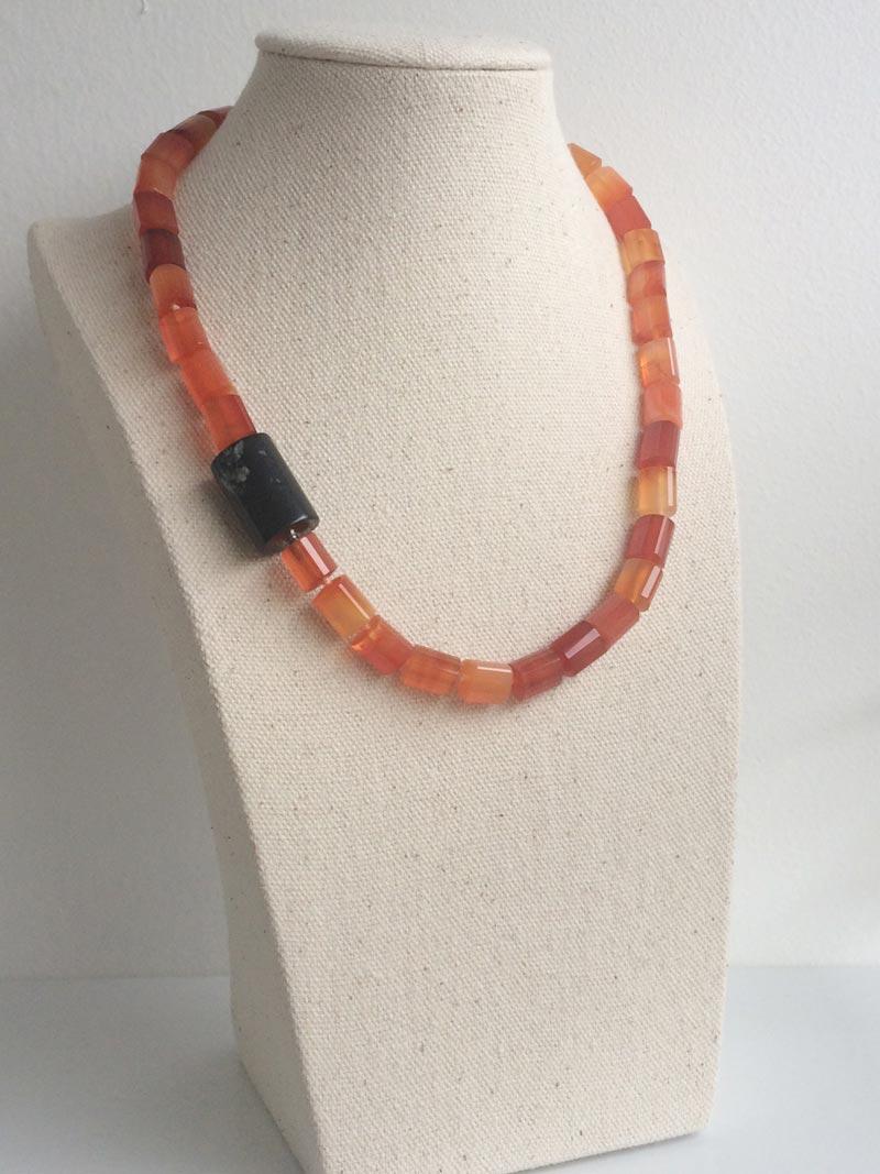 Triangular carnelian beaded necklace with detachable black onyx cylinder clasp