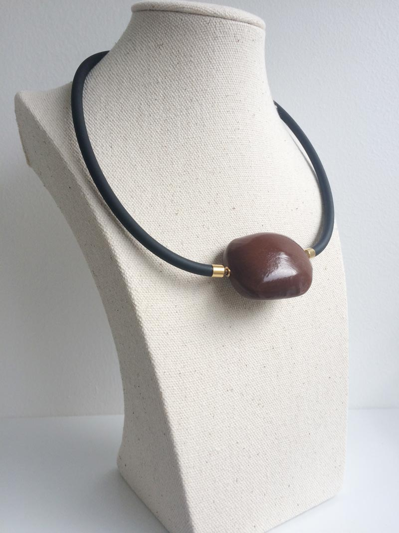Black rubber necklace with sea bean clasp