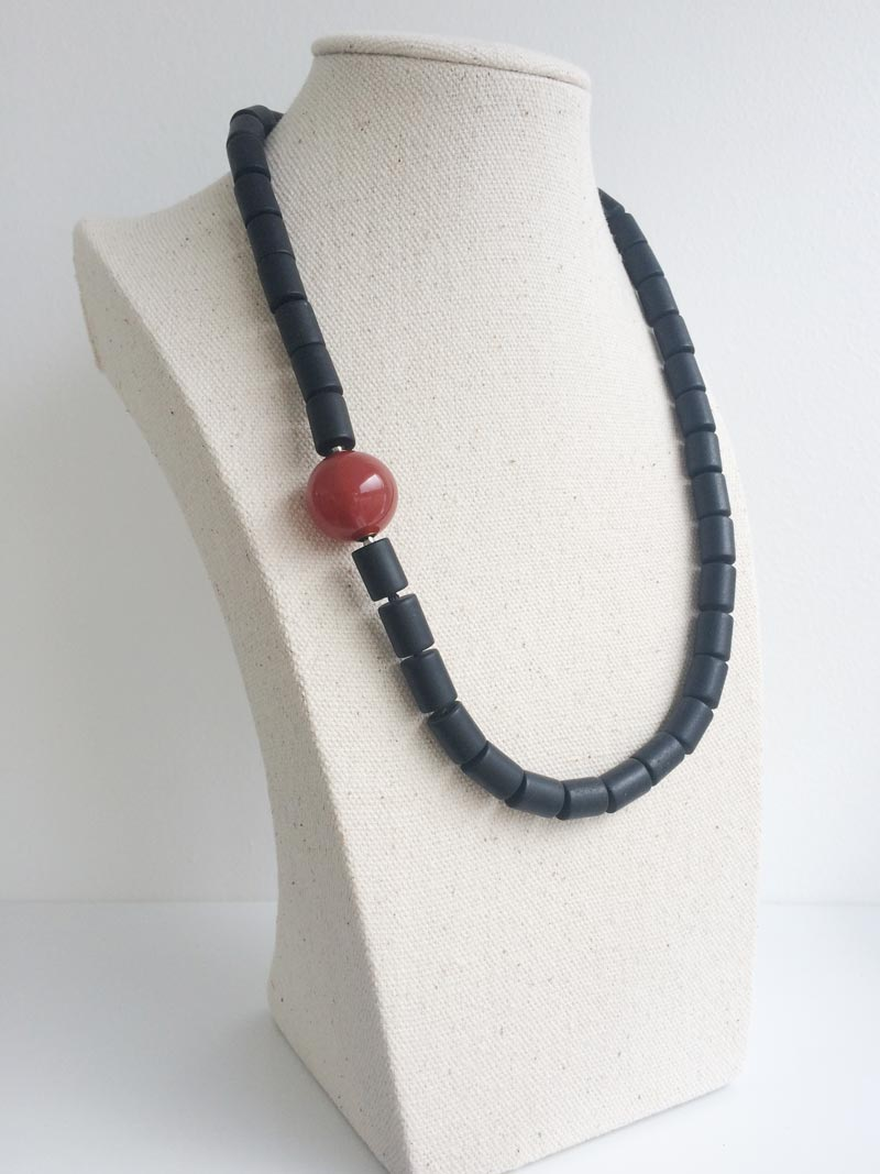10x8mm matte black onyx clylinder necklace with carnelian feature clasp