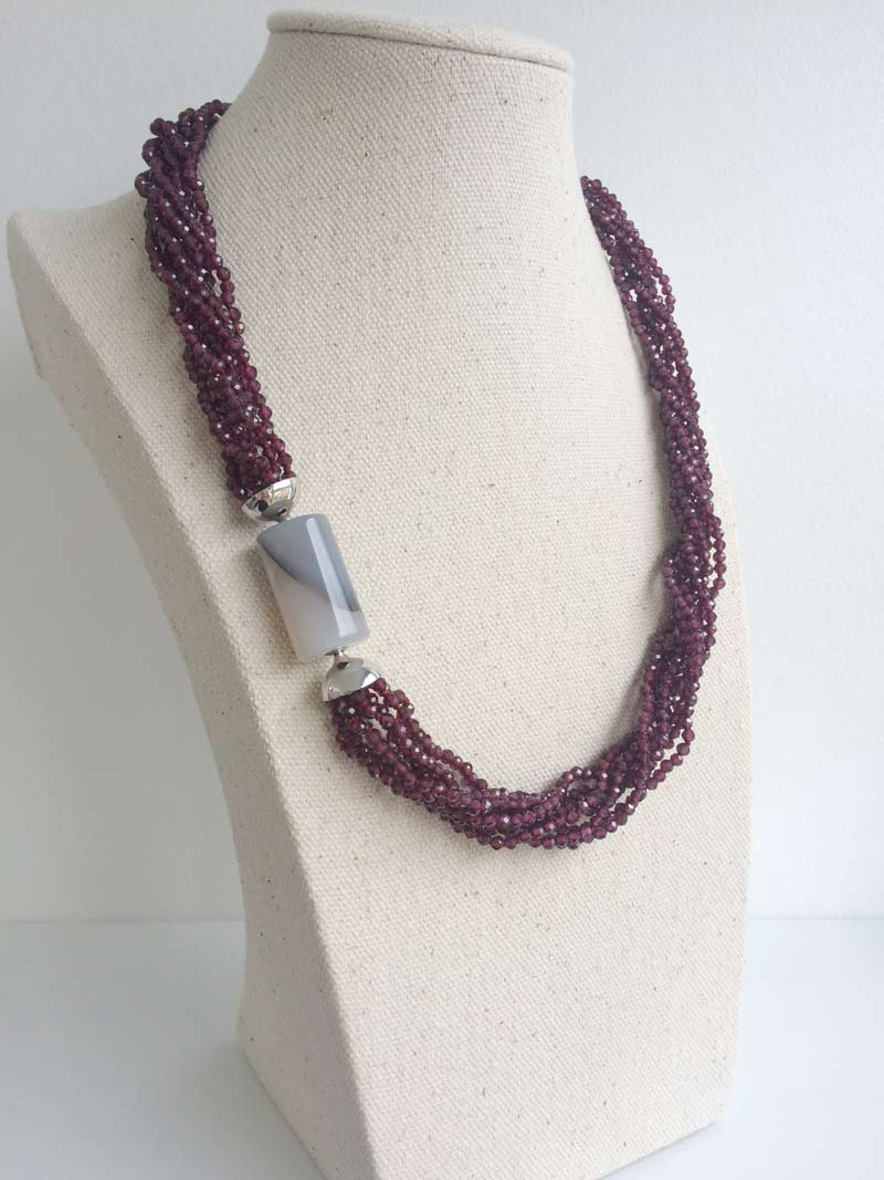 Faceted garnet multistrand necklace with interchangeable grey agate cylinder clasp
