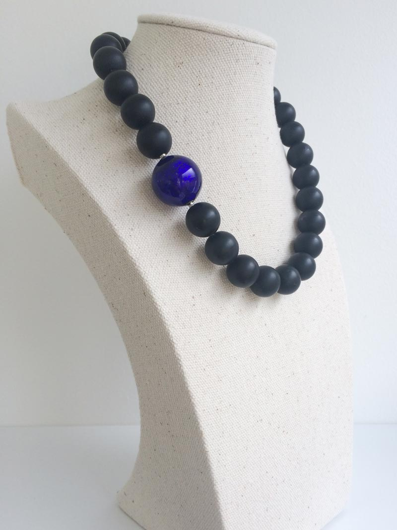 Matte black onyx bead strand withinterchangeabe blue Murano glass feature clasp
