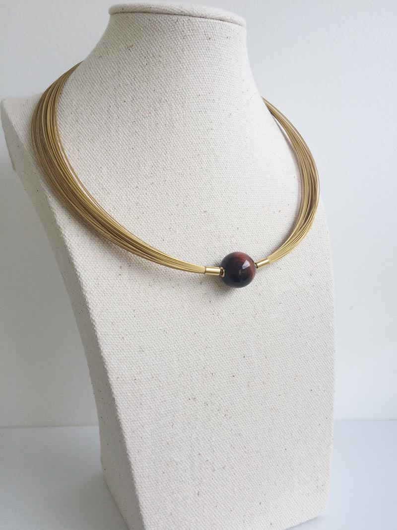 50 row gold wire multistrand necklace with red tiger's eye feature clasp