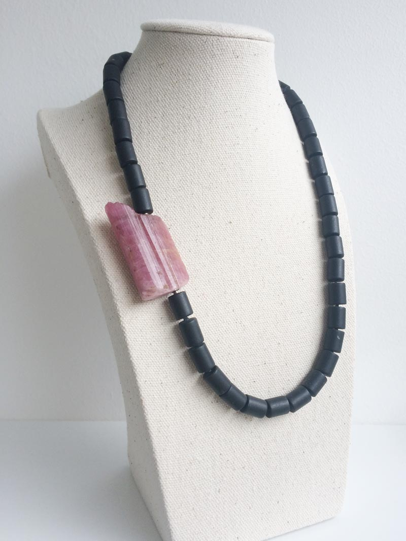 Matte black onyx cylinder necklace with interchangeable pink tourmaline feature clasp