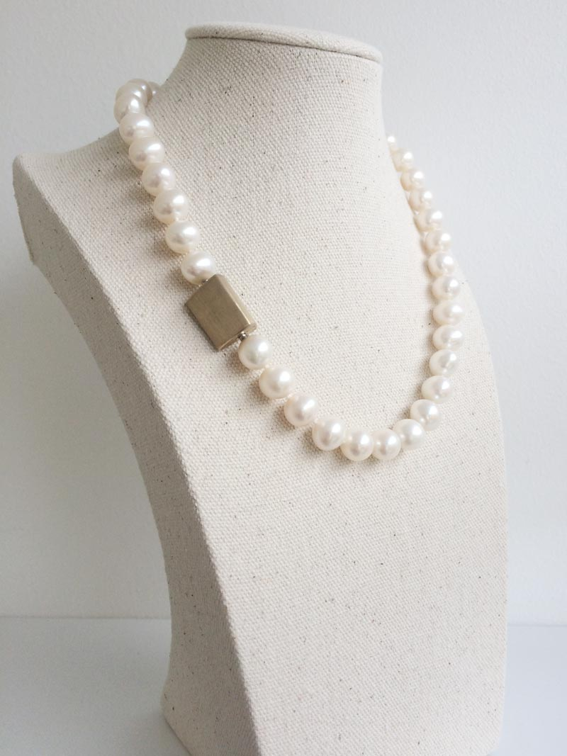 10-11mm potato shaped cream freshwater pearls with interchangeable triangular gold feature clasp