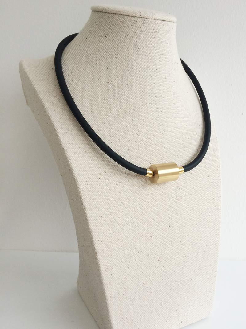 Black rubber with large gold cylinder clasp