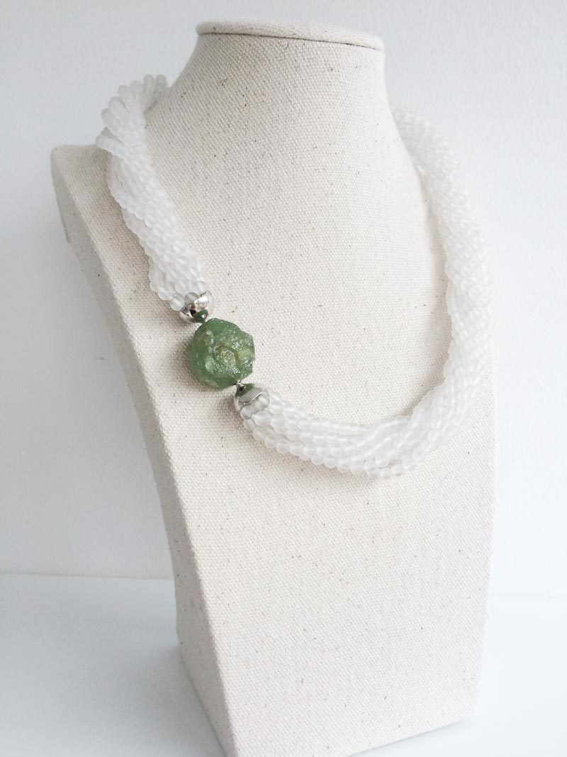 Matte rock crystal multistrand necklace with tsavorite garnet feature clasp