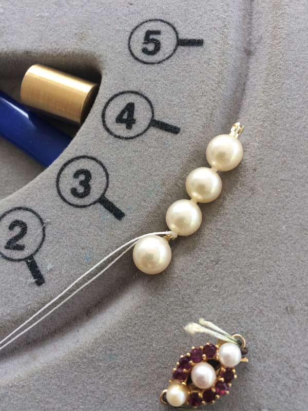 Drilled end pearls and first three knots