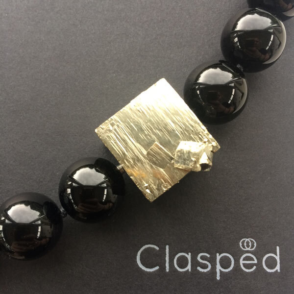 Extra long black onyx bead necklace with interchangeable pyrite feature clasp