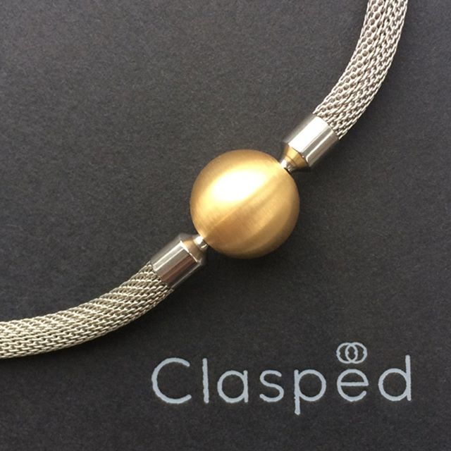 Here's one for the weekend. Our steel mesh slinky necklace with interchangeable gold ball clasp from clasped.ie #architecturaljewellery #Clasped #twotonenecklace #interchangeablejewellery #contemporaryjewellery #interchangeablenecklace #dublindesign #designernecklace #steelnecklace