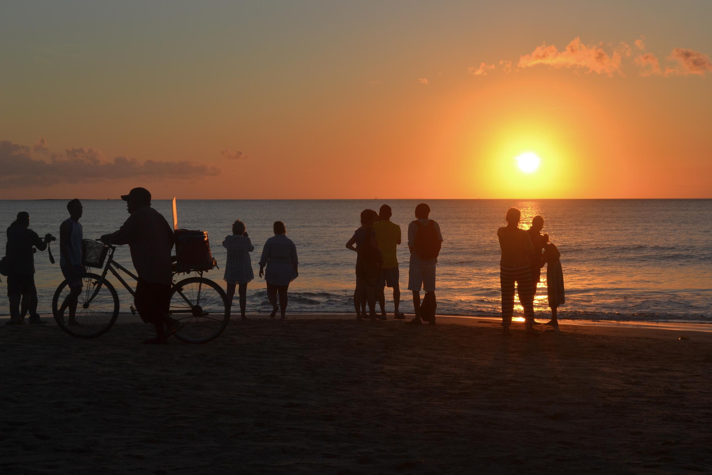 bali jimbaran bay sunset voyage collective beach