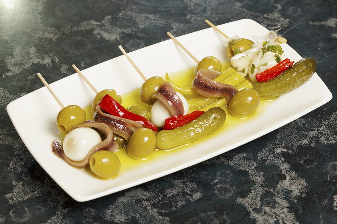 Gildas - Bite-sized delights on a toothpick with green olives, pepperoncinis, and anchovies.