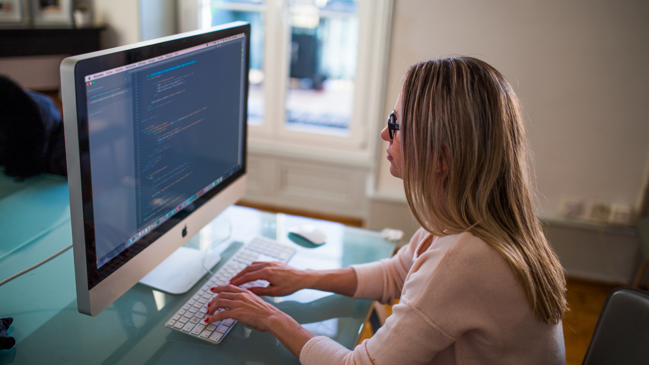 Woman-working-on-the-SEO-of-their-company's-blog.png