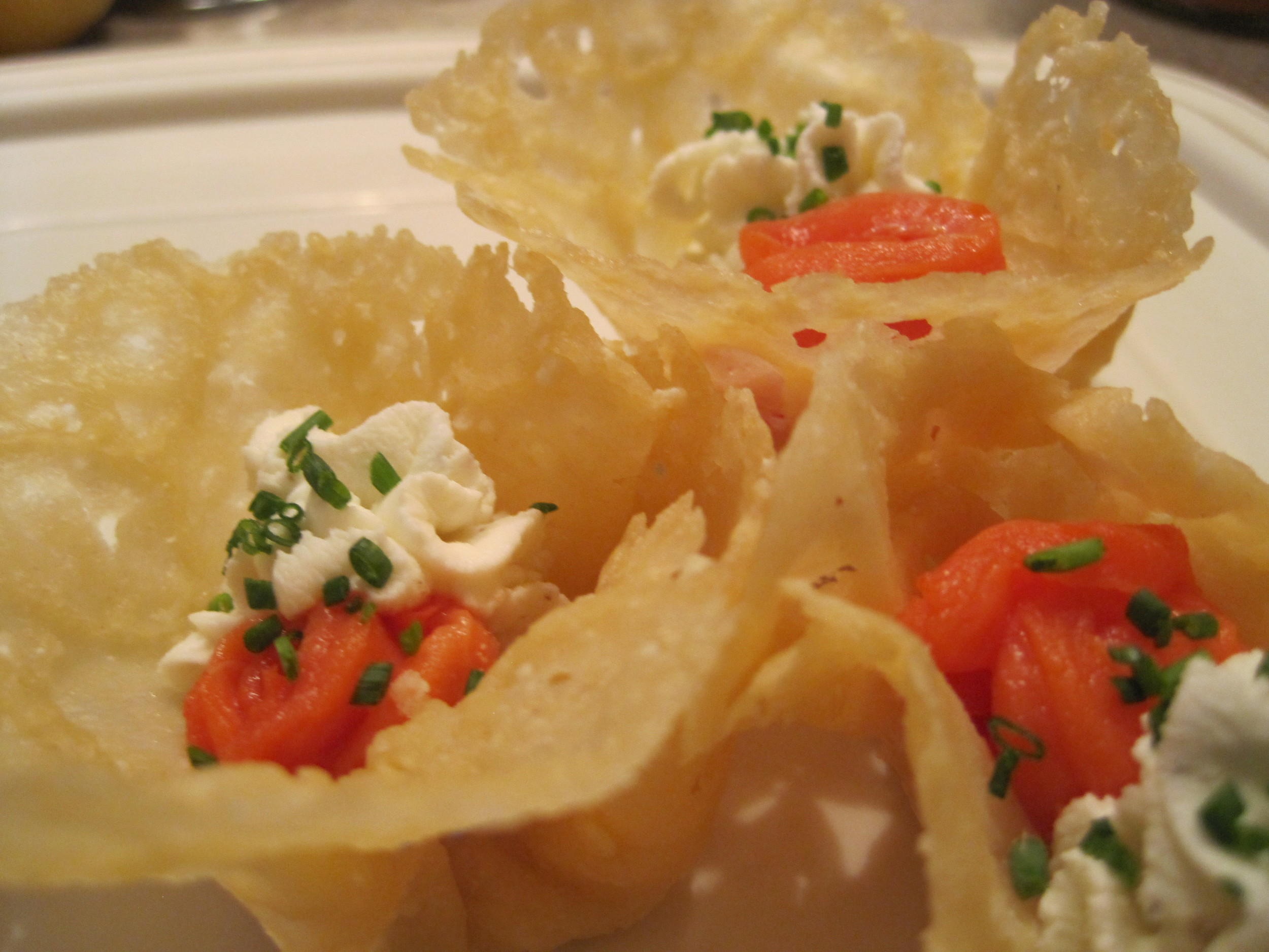Parmesan cups with rosettes of smoked salmon and roasted black pepper chevre