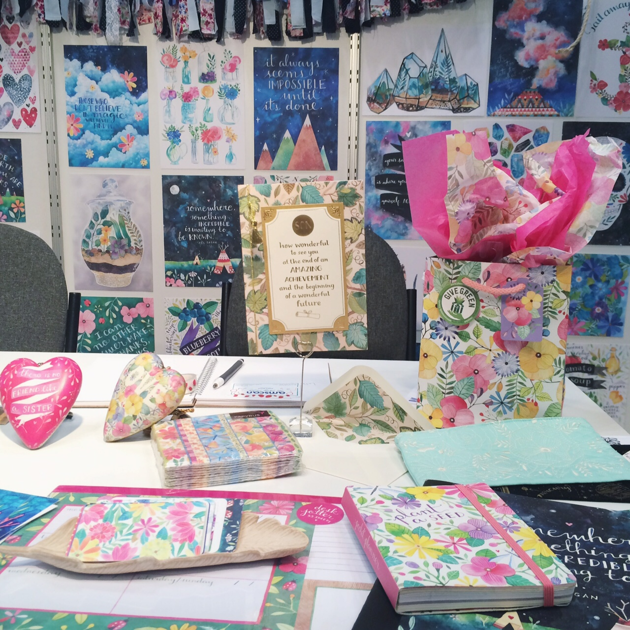 My desk with new products I showcase, usually from deals that came from last year's show.