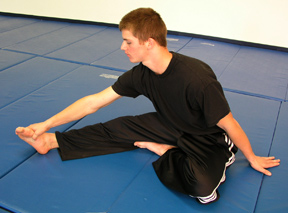 Exercise #5: Reach for your extended foot with the goal of touching your chest to your knee.