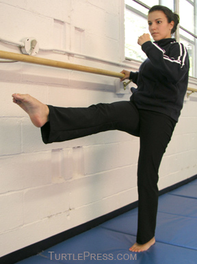 Slowly raise your leg while holding onto a support.