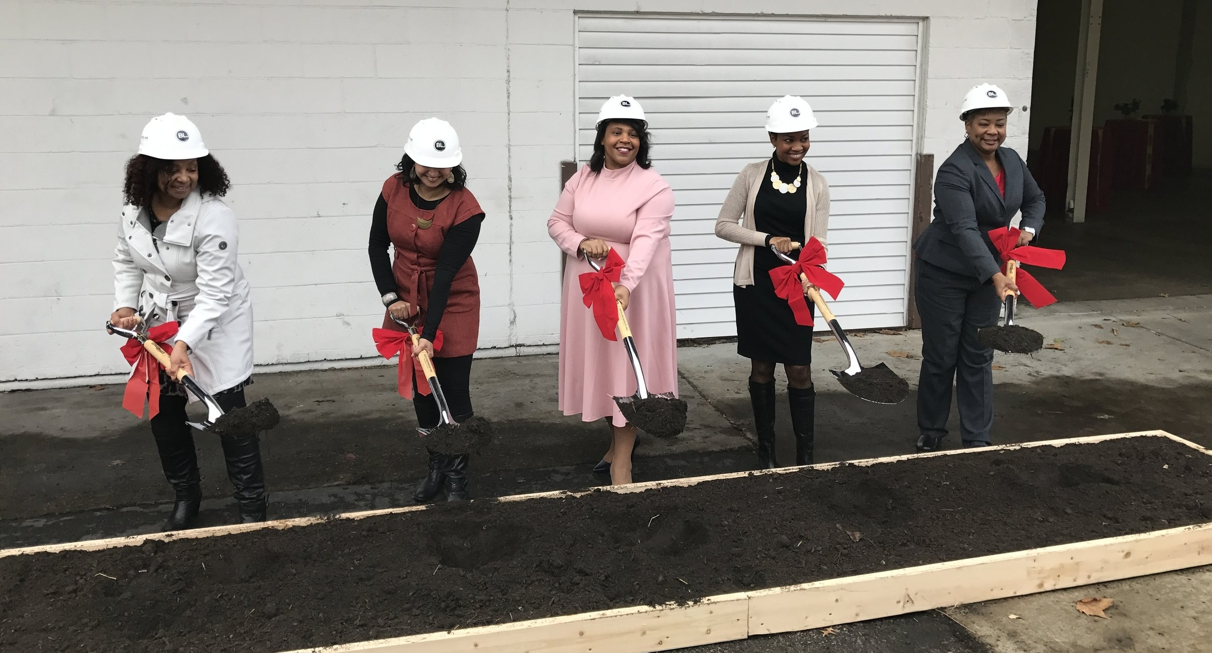 Ellicia Qualls, Founder of Urban Sprouts (middle) breaks ground with her colleagues -