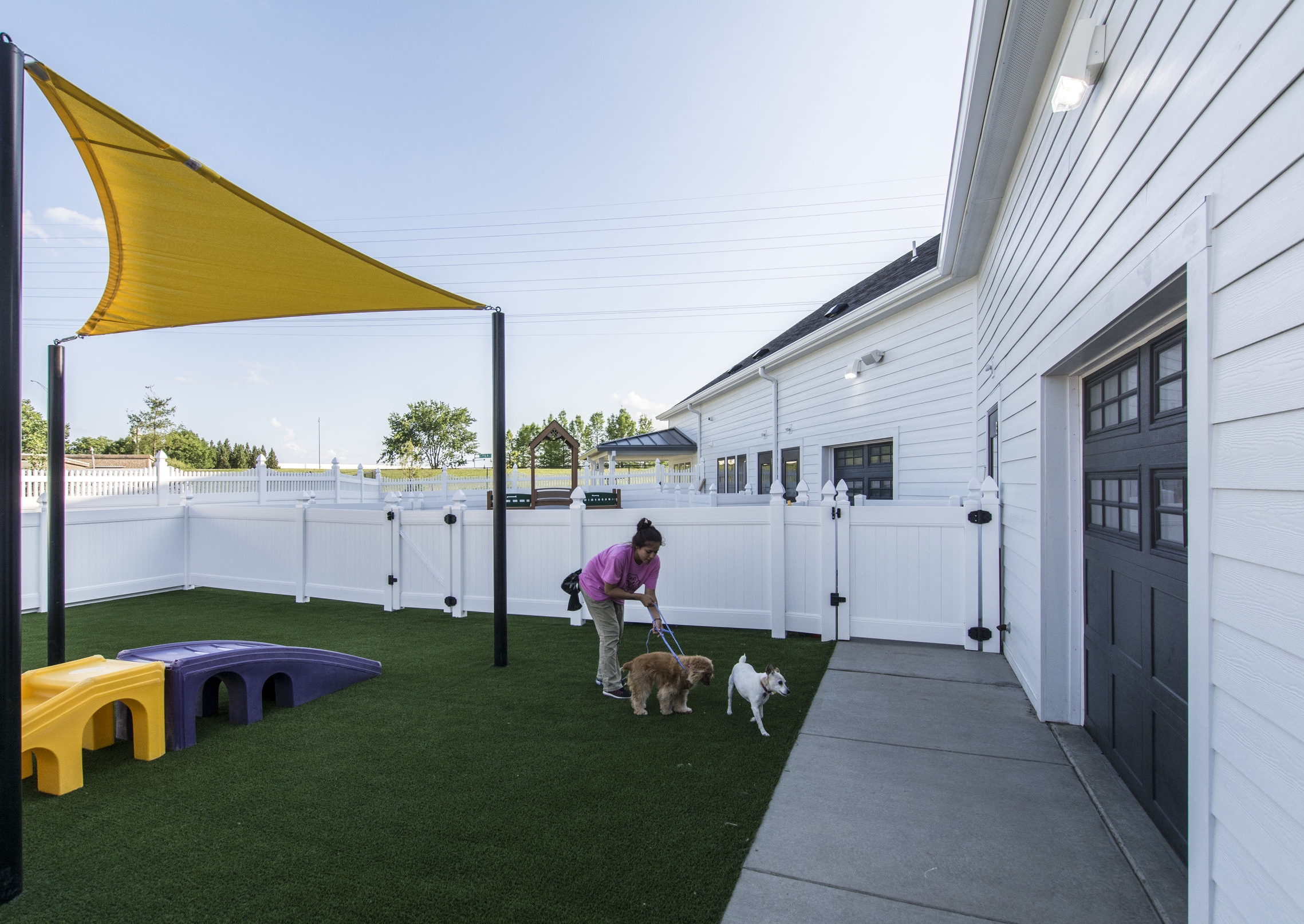 Outdoor areas simulate a typical lawn. Canvas structures provide shade -