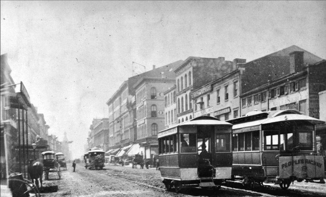 View of St. Louis in the late 1800's. Dirt streets with new cable cars -