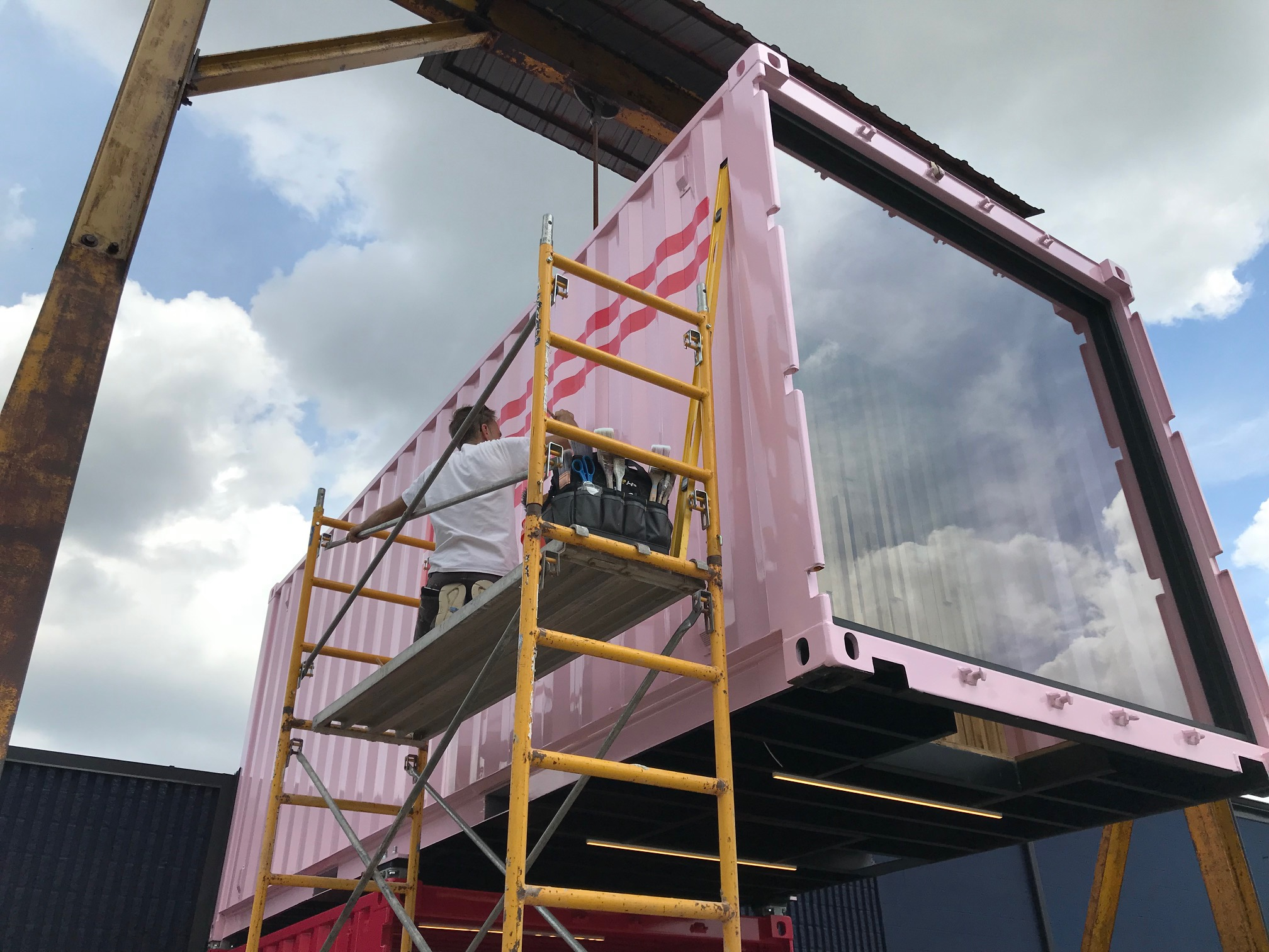 Signage being painted on the entry shipping container -