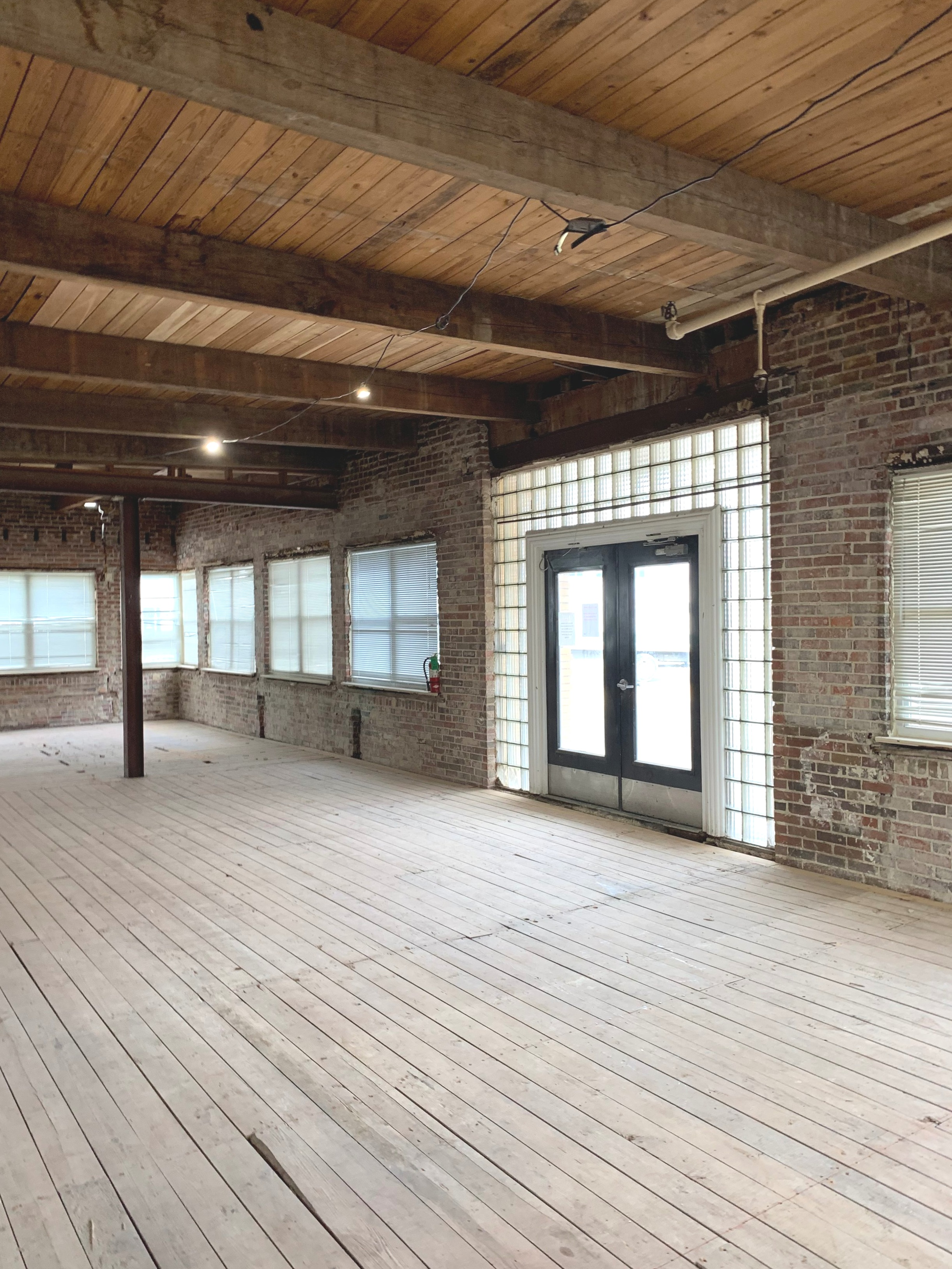 Existing space: original wood floors, brick and timber roof structure