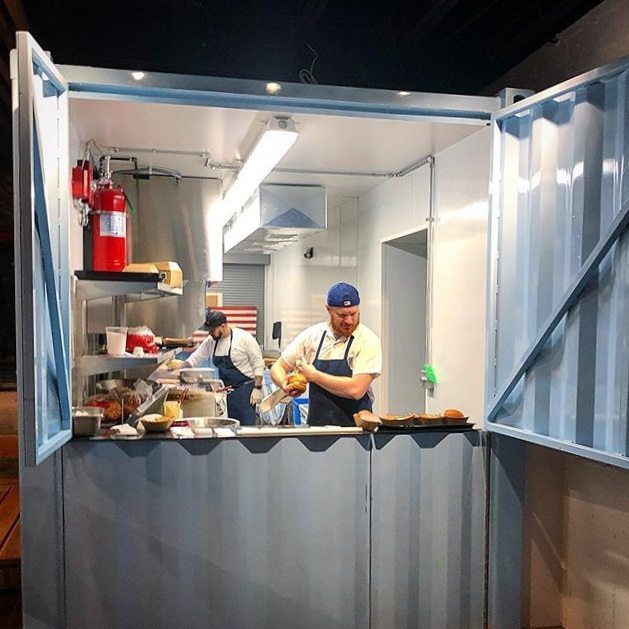 Brasswell's kitchen is located in 1/2 of a shipping container that has an indoor and outdoor service window.