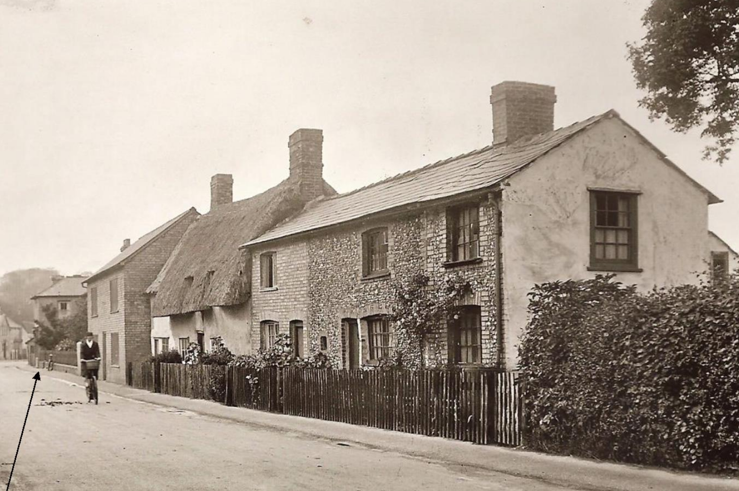 The Clock Shop is the last in the row of the house on this photo (see arrow). This photo was taken in 1931.