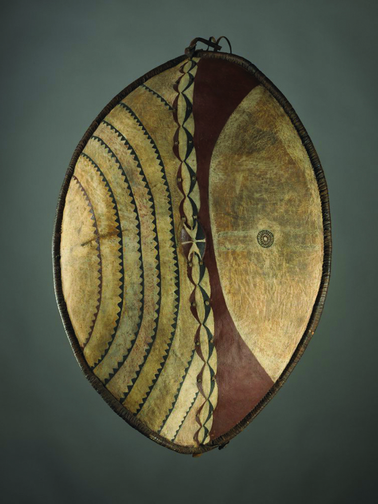 Maasai traditional buffalo hide shield with red ochre and black pigment (both mixed with buffalo blood), and a circular design that marked its bearer as a decorated veteran in war and as a lion hunter (  British Museum collection, research specimen number AN00521410_001)