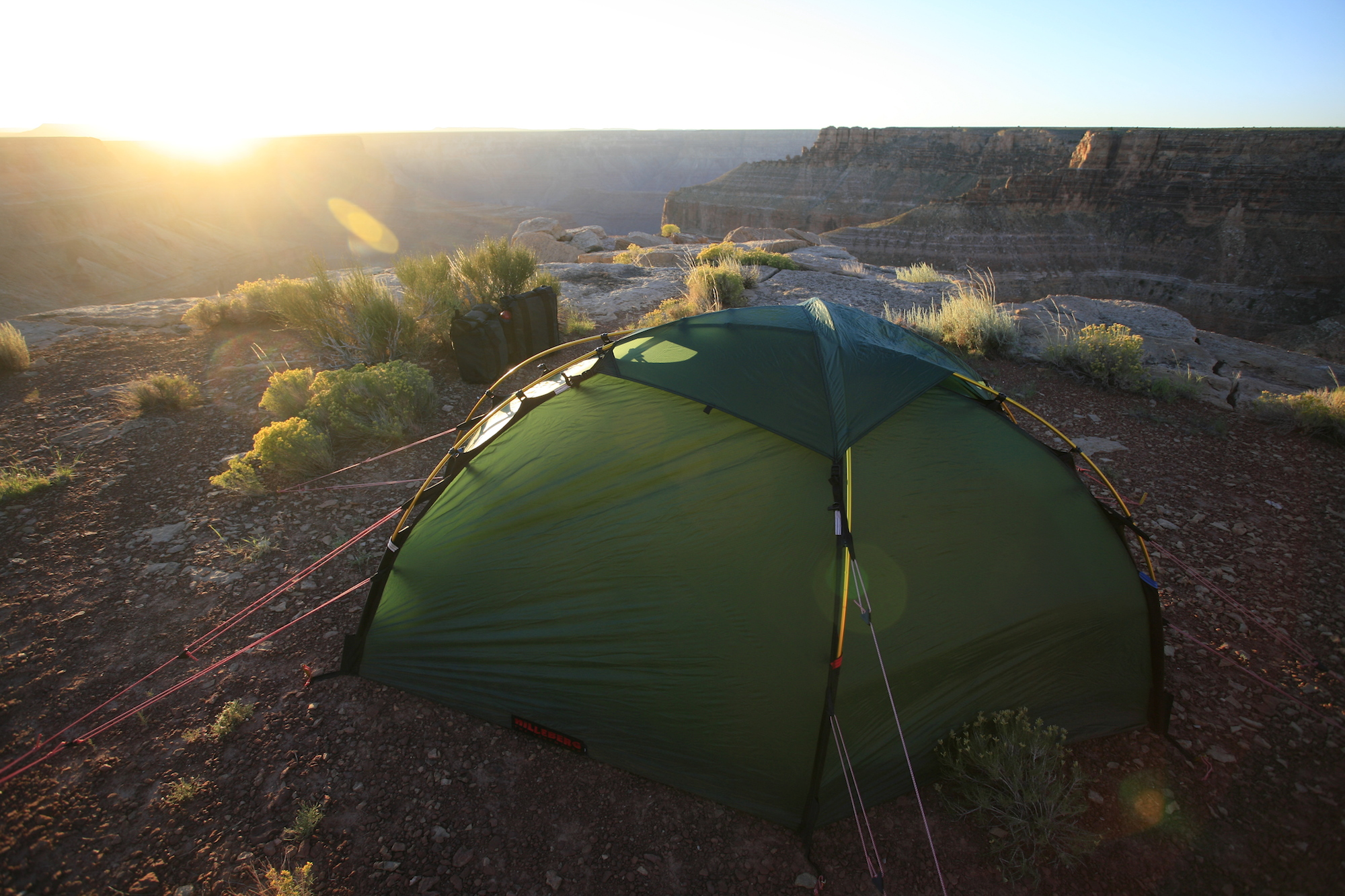 A superb Hilleberg Soulo single-person tent, well-guyed and staked against Grand Canyon katabatic gusts.