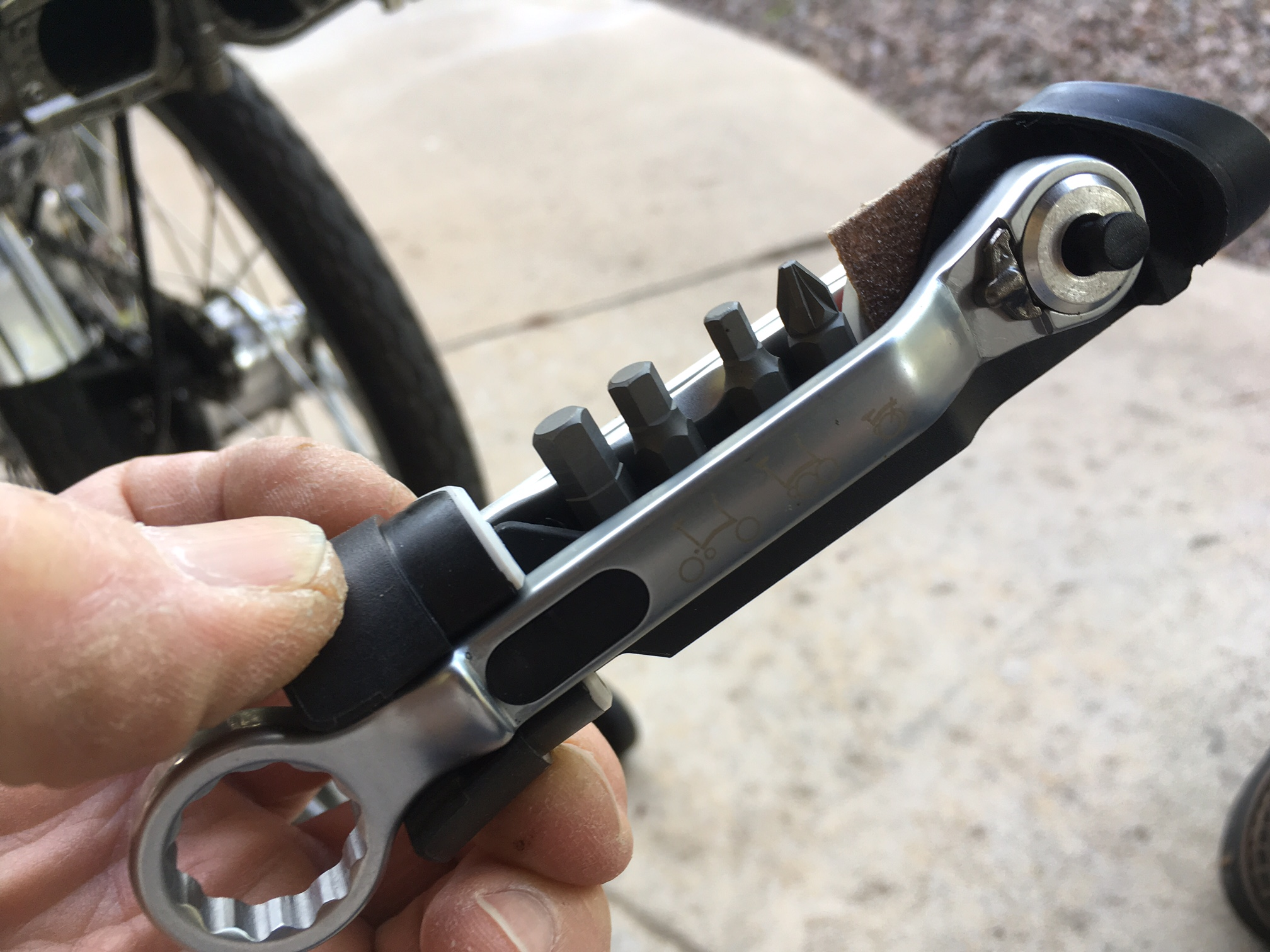 A clever, rattle-free (optional) tool kit held in with a magnet. It includes tire levers and patches.