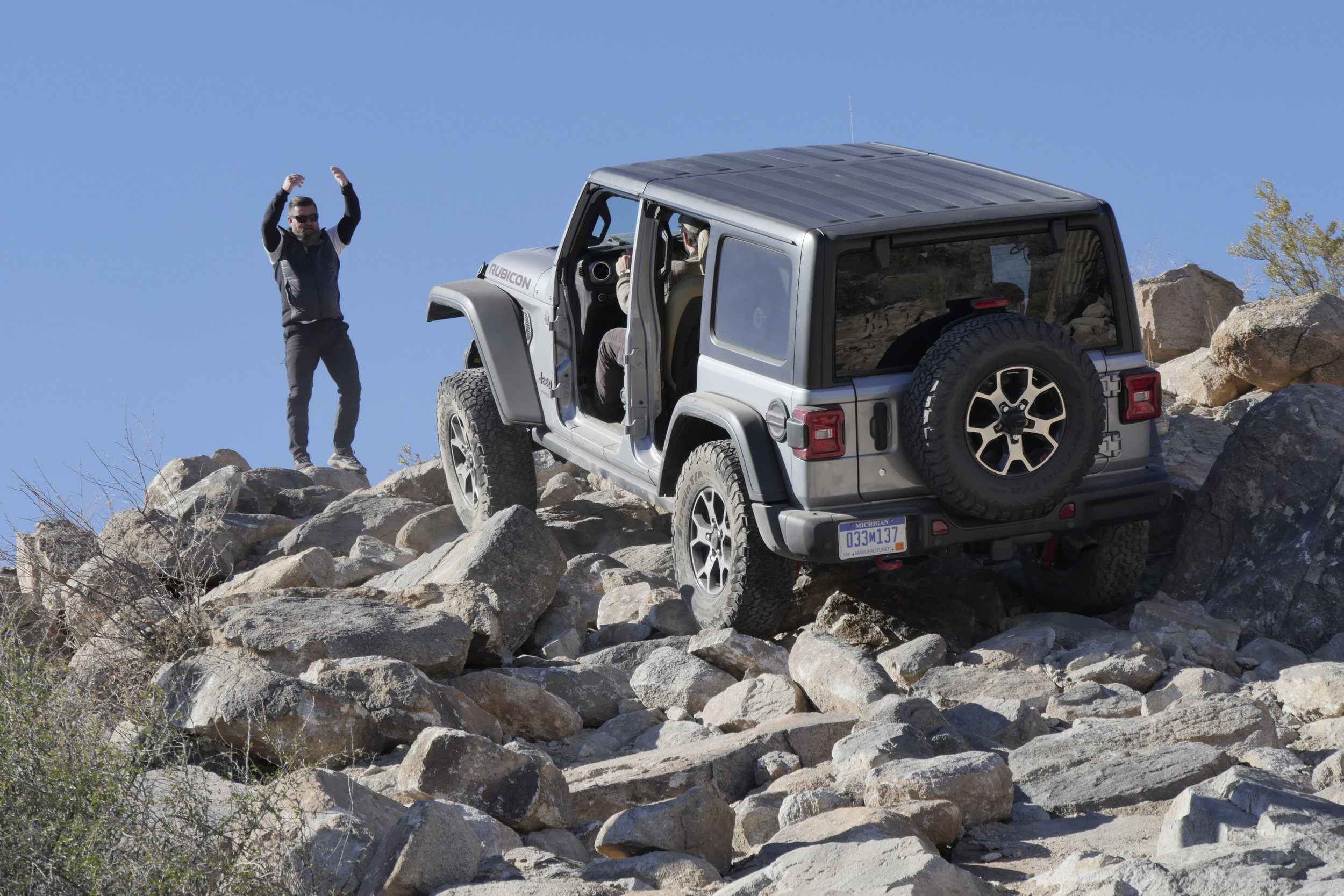 Jim Horne guides a 2018 Wrangler Rubicon Unlimited up the demo course climb.