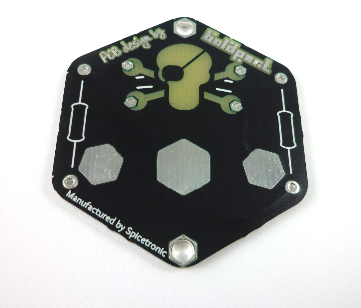 Back of the badge -- the three large pads are for a battery holder