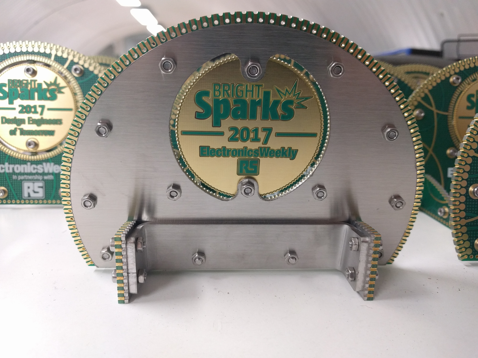 The back of the trophy. The main body and stands have a 1.5mm thick stainless steel backing attached with M3 screws and nuts. A custom 3mm thick stainless bracket holds everything together and adds weight. The position of the bracket also lowers the centre of gravity so that the piece sits solidly on the surface.