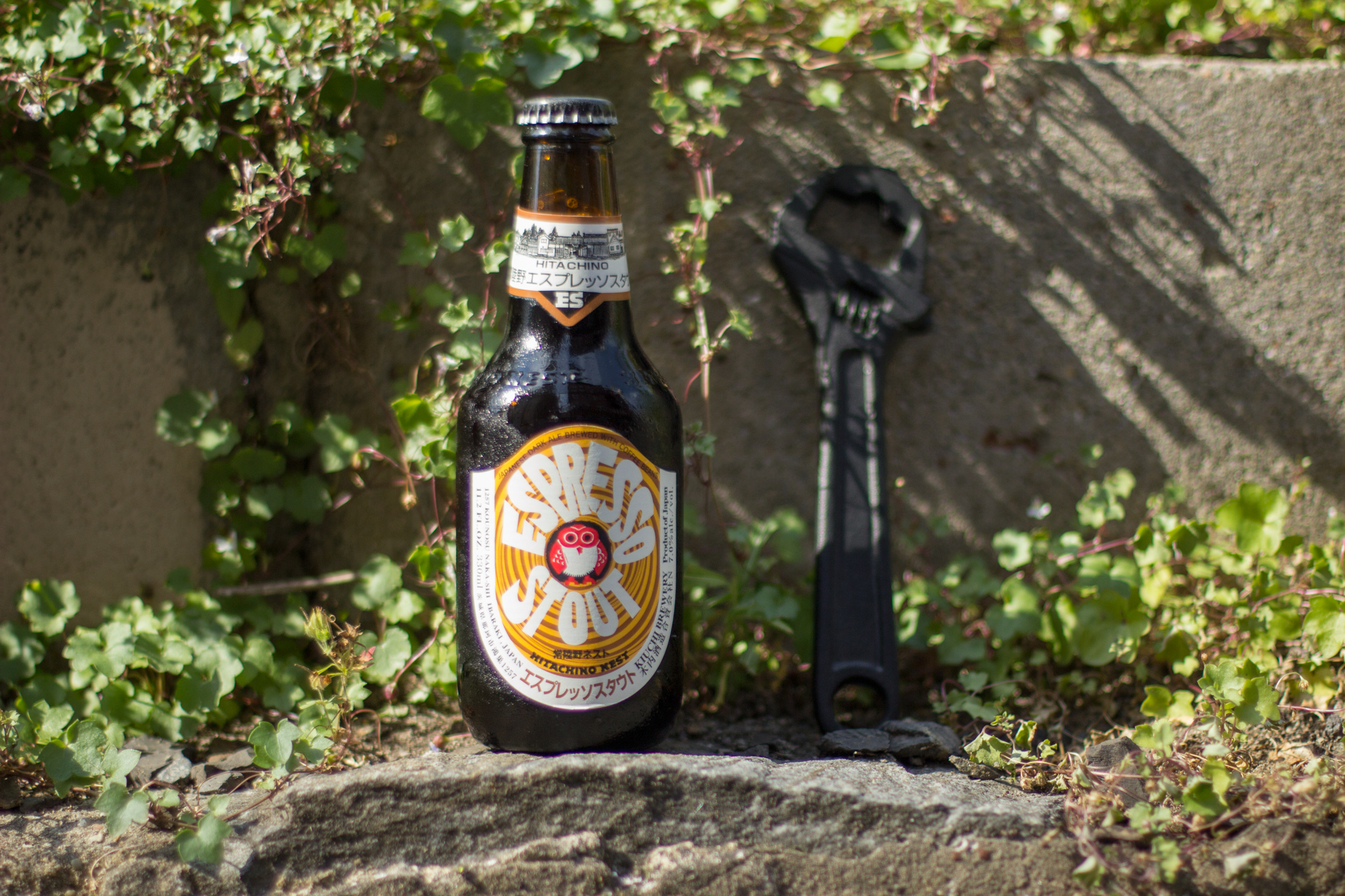 Hitachino Nest  : Espresso Stout and our  cast iron wrench bottle opener .