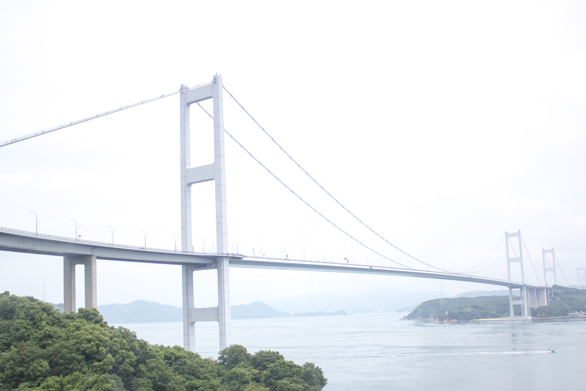 Shimanami Kaido  is a toll road connecting Japan's main island of Honshu with the island of Shikoku, all overlooking the  Seto Inland Sea .