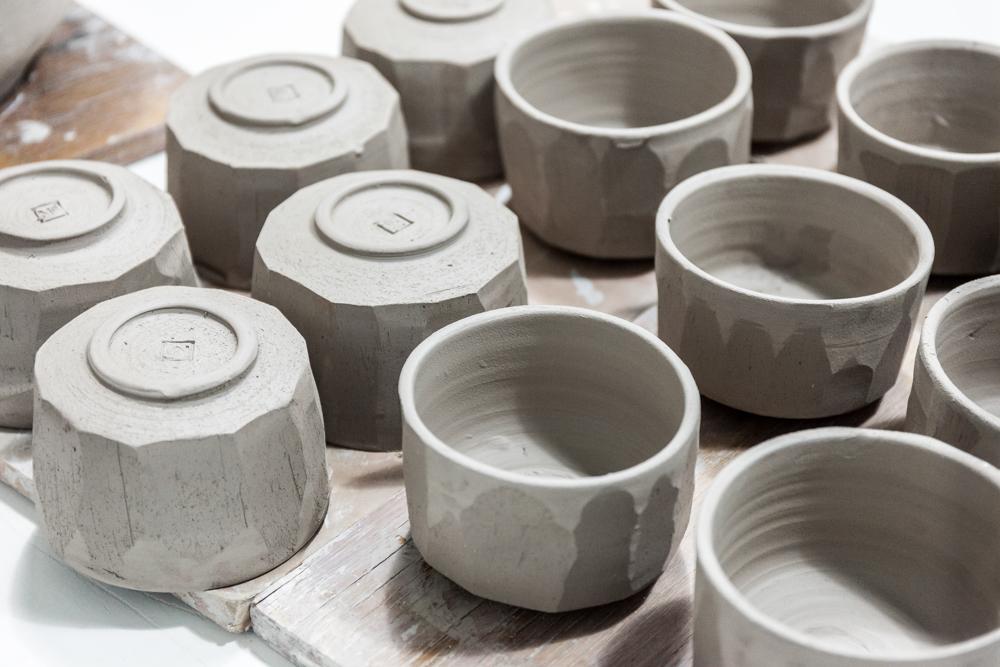 A fresh batch of No. for Rikumo Mokutan bowls ready to glaze.