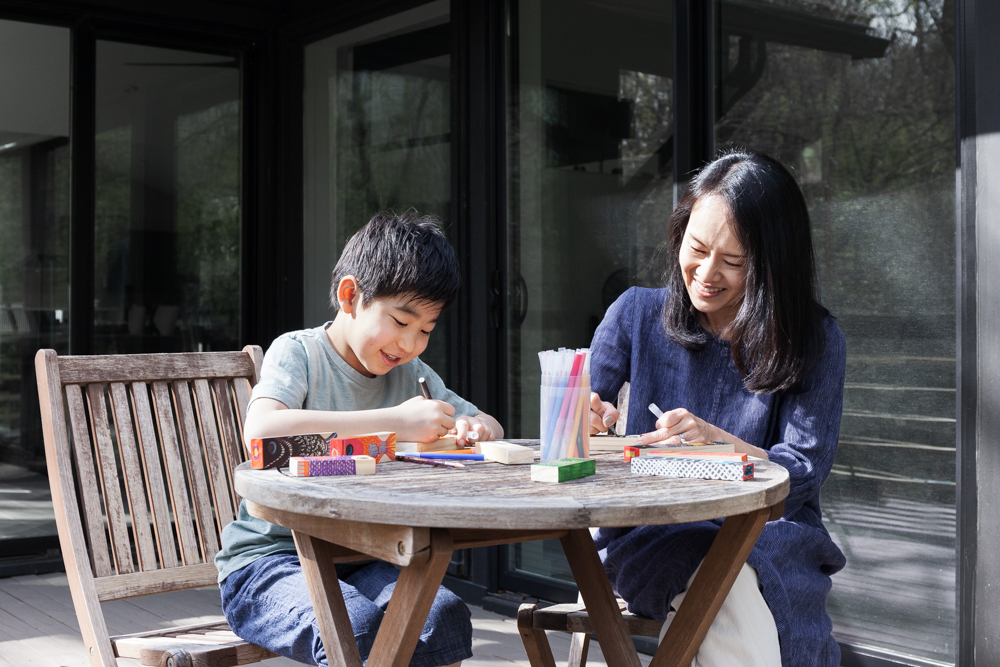 Our founder Yuka and son Riku, pictured here making some wooden koinobori of their own.