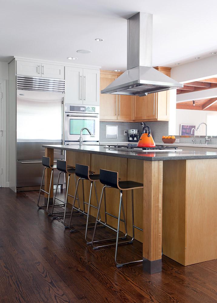 Custom maple island cabinet/Concrete countertop/New hardwood flooring