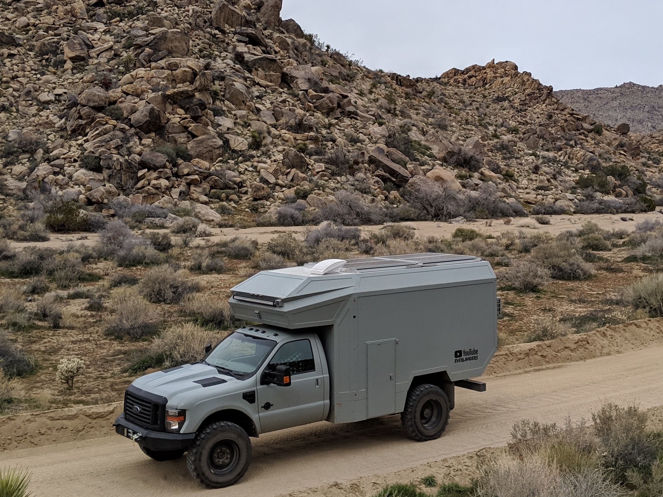 The Everlander is a custom self built composite panel overland rig built on a 7.3L Diesel 4x4 F-550 chassis. 1500 watts of solar on an expanding rooftop array provides the sole source of energy for the habitation box. Canadian duo, Jason and Kara are currently on a 9 month trip through Canada, US and Mexico.