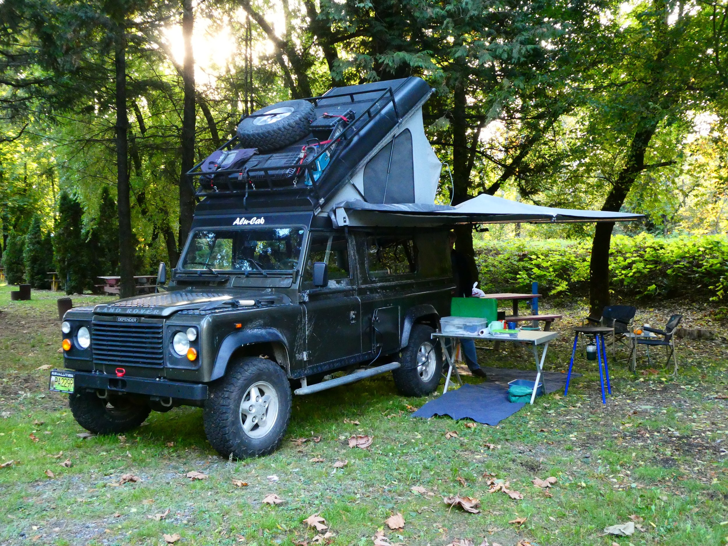 Meet David's 1995 Land Rover Defender 'Fitz', named because everything fits! This particular Land Rover was originally a military truck on the British Army base in Suffield, Alberta, which was used as their desert training area. When they decided to embark on a global overland trip we weighed the pros and cons of many vehicle configurations, of course each having to be a compromise in some way. They selected the 3 - door Defender 110 because of its off-road capability, its narrow width, its interior storage area and its easy configurability due to the bolt-together construction.The Land Rover's simplistic design and non-electronic powertrain make it easy to fix on the side of the road with basic hand tools. Reliability can be significantly improved by proper selection of replacement parts but admittedly you need to be prepared to do some DIY mechanics on any overland adventure. They continue to take the truck on limited (2-3 week) shakedown trips in anticipation to full time travel starting in 2020.